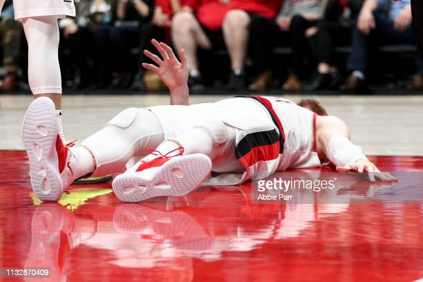 Jusuf Nurkic of the Portland Trail Blazers reacts after suffering an apparent broken leg against the Brooklyn Nets in double overtime during their...