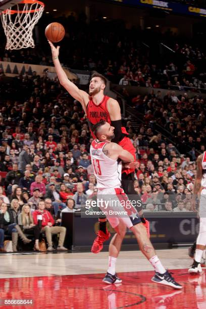 Jusuf Nurkic of the Portland Trail Blazers shoots the ball against Marcin Gortat of the Washington Wizards on December 5 2017 at the Moda Center in...