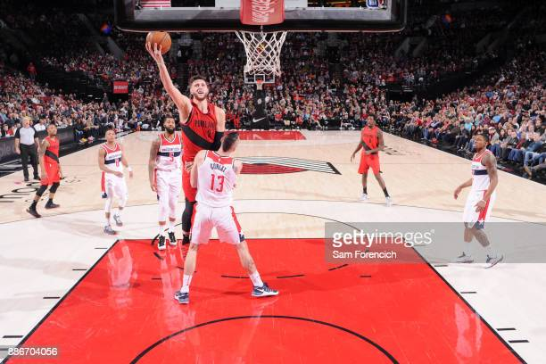 Jusuf Nurkic of the Portland Trail Blazers shoots the ball against the Washington Wizards on December 5 2017 at the Moda Center in Portland Oregon...