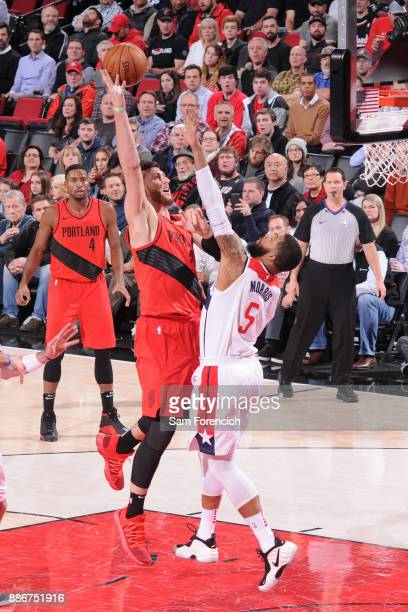 Jusuf Nurkic of the Portland Trail Blazers shoots the ball against Markieff Morris of the Washington Wizards on December 5 2017 at the Moda Center in...
