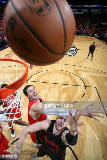 Jusuf Nurkic of the Portland Trail Blazers shoots the ball around Nikola Mirotic of the New Orleans Pelicans in Game Three of Round One of the 2018...