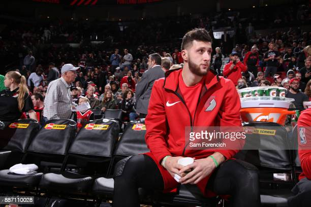 Jusuf Nurkic of the Portland Trail Blazers sits on the bench before the game against the Washington Wizards on December 5 2017 at the Moda Center...