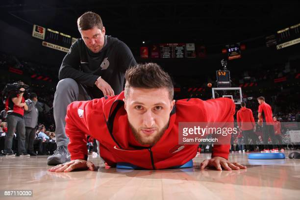 Jusuf Nurkic of the Portland Trail Blazers stretches before the game against the Washington Wizards on December 5 2017 at the Moda Center Arena in...