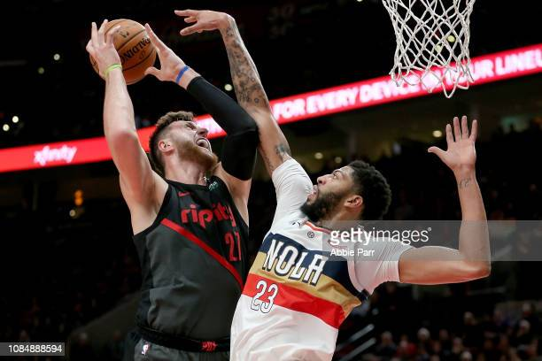 Jusuf Nurkic of the Portland Trail Blazers takes a shot against Anthony Davis of the New Orleans Pelicans in the first half during their game at Moda...