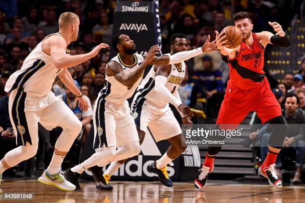 Jusuf Nurkic of the Portland Trail Blazers wrangles a ball away from Will Barton of the Denver Nuggets as Mason Plumlee and Paul Millsap assist on...
