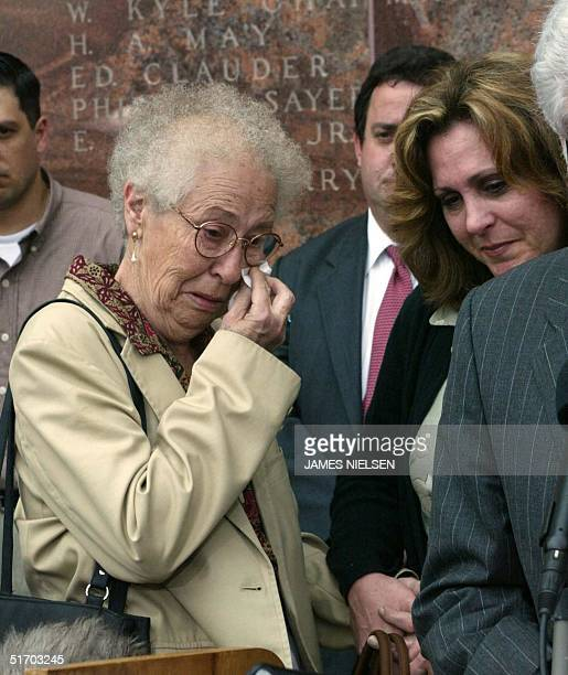Jutta Kennedy , mother of Andrea Pia Yates, with her daughter Maureen Freeman wipes tear from her face outside the Harris County Courthouse after her...