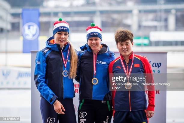 Jutta Leerdam of Netherlands Femke Beuling of Netherlands and Nan Sun of China pose in the Ladies 500m medal ceremony during day two of the ISU...