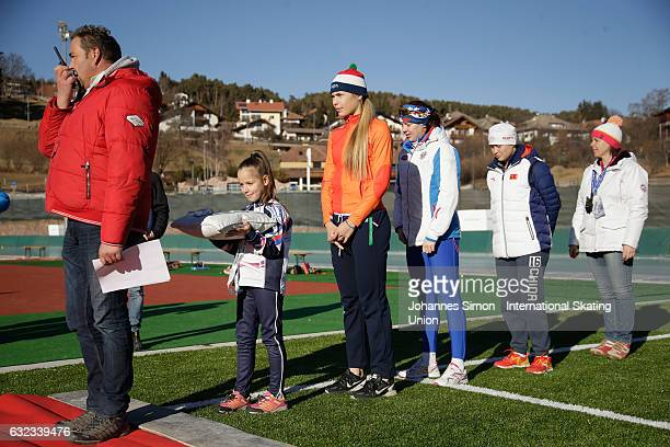 Jutta Leerdam of the Netherland Daria Kachanova of Russia and Nan Sun of China arrive for the medal ceremony after winning the first women's junior...