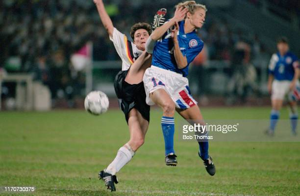 Jutta Nardenbach of Germany and Carin Jennings of the United States clash during play in the 1991 FIFA Women's World Cup semi final match between...