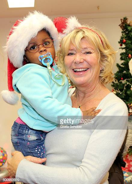 Jutta Speidel and Rachel pose during the Christmas party at Horizont eV on December 11 2015 in Munich Germany