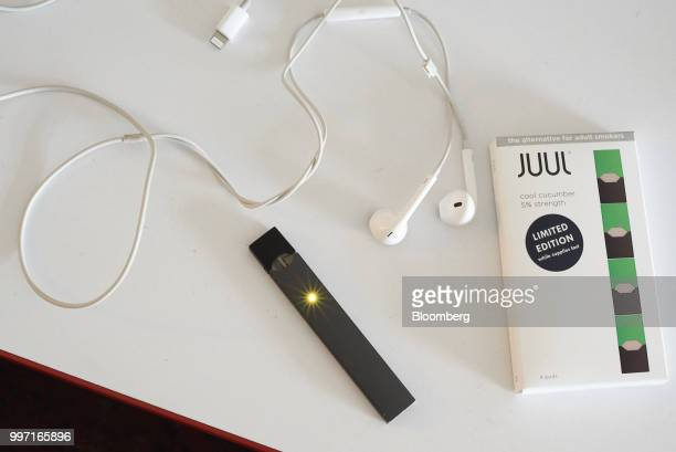 A Juul Labs Inc ecigarette and flavored pod are arranged for a photograph in the Brooklyn Borough of New York US on Sunday July 8 2018 Juul Labs the...