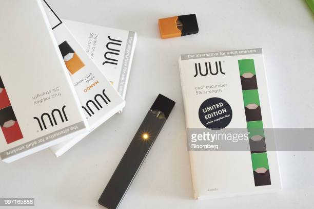 A Juul Labs Inc ecigarette and flavored pods are arranged for a photograph in the Brooklyn Borough of New York US on Sunday July 8 2018 Juul Labs the...