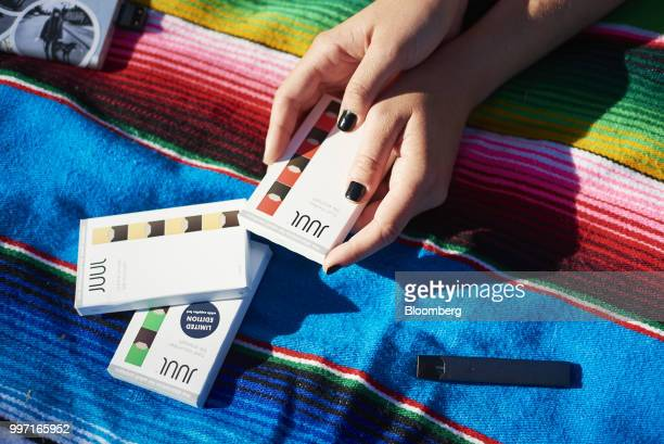Juul Labs Inc. E-cigarette and flavored pods are arranged for a photograph in the Brooklyn Borough of New York, U.S., on Sunday July 8, 2018. Juul...