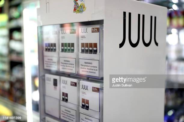Juul products are displayed at Smoke and Gift Shop on October 17, 2019 in San Francisco, California. Juul announced plans to immediately suspend...