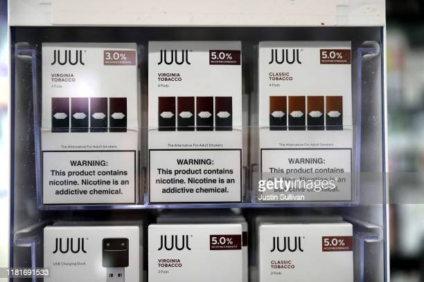 Juul products are displayed at Smoke and Gift Shop on October 17 2019 in San Francisco California Juul announced plans to immediately suspend sales...
