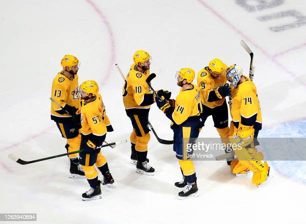 Juuse Saros and Filip Forsberg of the Nashville Predators celebrate the win with the rest of their teammates after the 4-2 win over the Arizona...