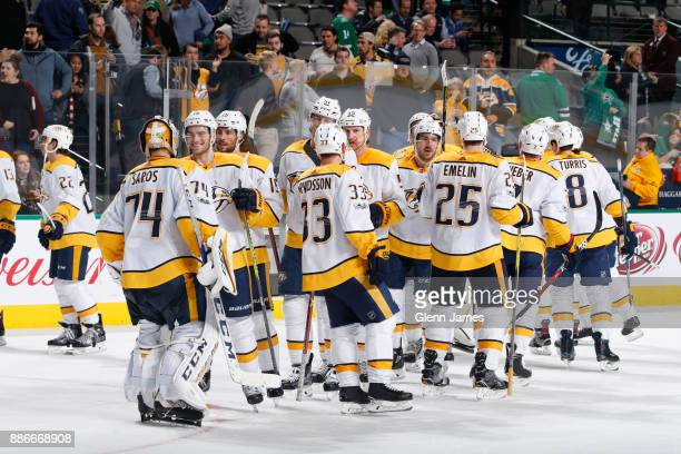 Juuse Saros and the Nashville Predators celebrate a goal against the Dallas Stars at the American Airlines Center on December 5 2017 in Dallas Texas
