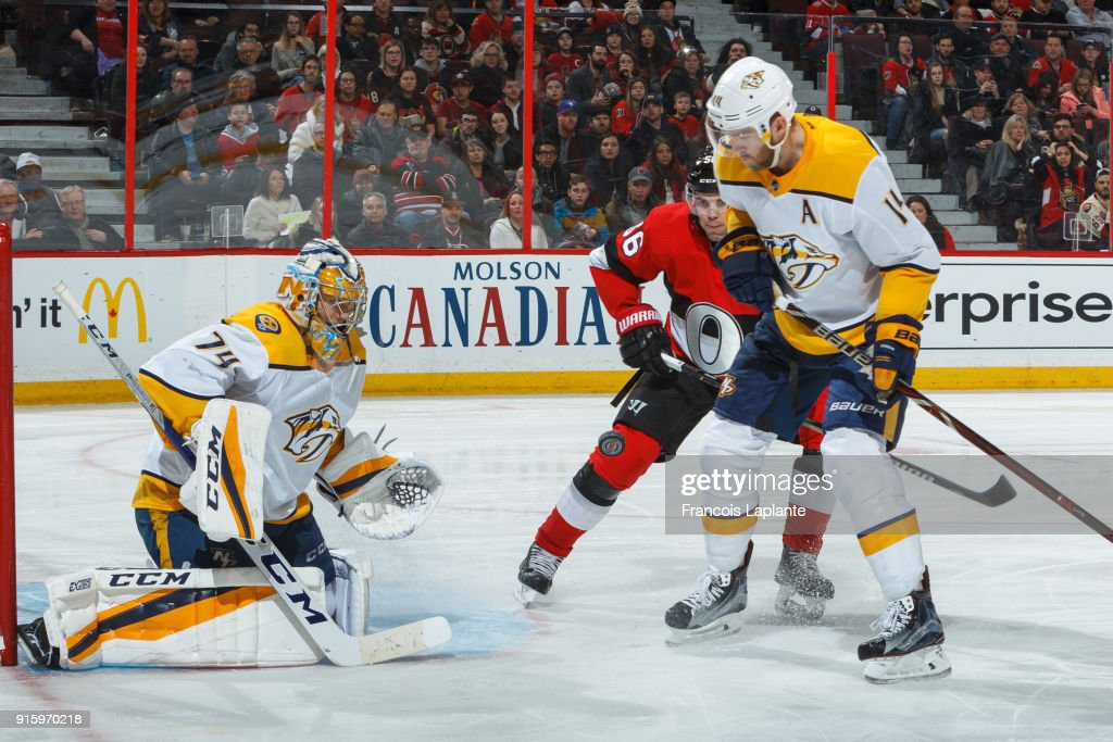 Juuse Saros #74 keeps track of an inbound shot as Mattias Ekholm #14 defends against Magnus Paajarvi #56 of the Ottawa Senators at Canadian Tire Centre on February 9, 2018 in Ottawa, Ontario, Canada.