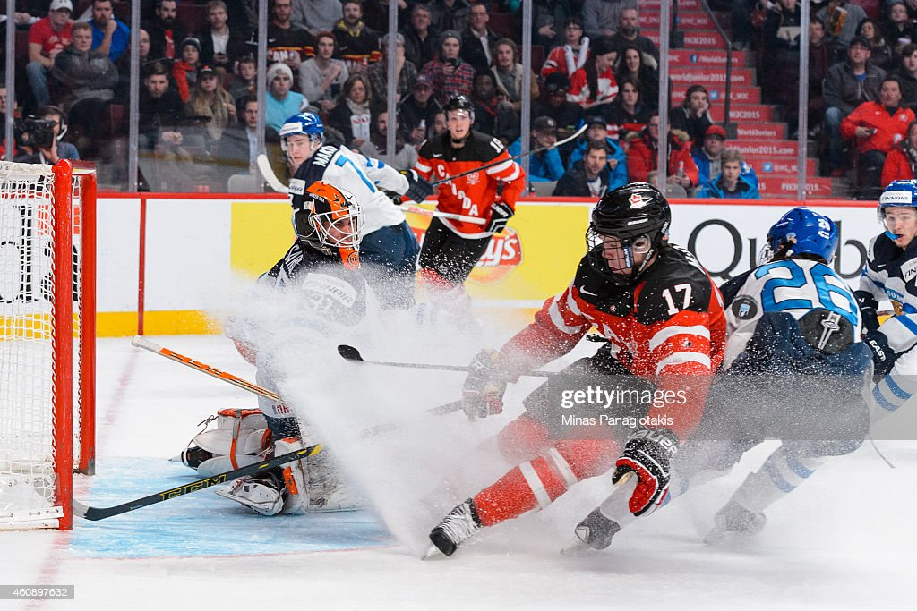 Juuse Saros #31 of Team Finland gets some ice spray from Connor McDavid #17 of Team Canada during the 2015 IIHF World Junior Hockey Championship game at the Bell Centre on December 29, 2014 in Montreal, Quebec, Canada.
