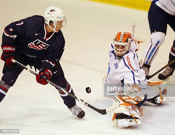 Juuse Saros of Team Finland makes the second period save against Anders Bjork of USA Blue during the 2014 USA Hockey Junior Evaluation Camp at the...