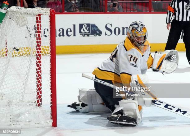 Juuse Saros of the Nashville Predators cannot block a shot from Sebastian Aho of the Carolina Huuricanes during a shootout of an NHL game on November...