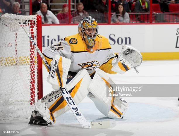 Juuse Saros of the Nashville Predators crouches in the crease to defend the goal during an NHL game against the Carolina Hurricanes on November 26...