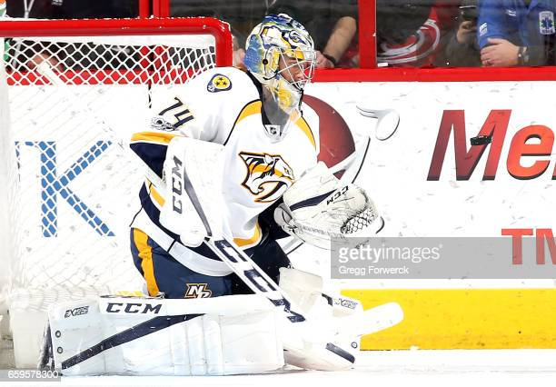 Juuse Saros of the Nashville Predators goes down in the crease and keeps his eye on the puck during an NHL game against the Carolina Hurricanes on...