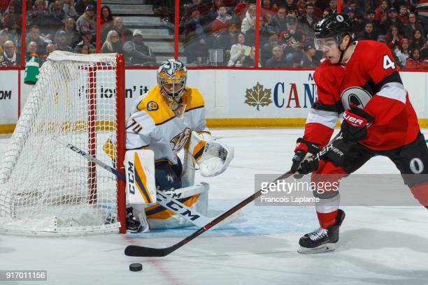 Juuse Saros of the Nashville Predators guards his net against JeanGabriel Pageau of the Ottawa Senators at Canadian Tire Centre on February 9 2018 in...