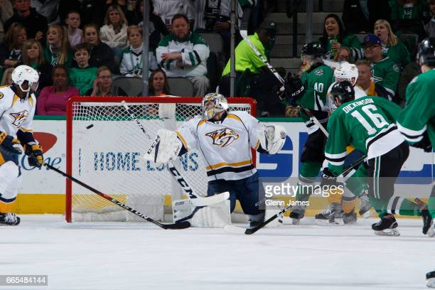 Juuse Saros of the Nashville Predators has a puck fired past him against Jason Dickinson of the Dallas Stars at the American Airlines Center on April...