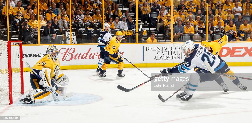 Juuse Saros #74 of the Nashville Predators makes the save against Paul Stastny #25 of the Winnipeg Jets in Game Seven of the Western Conference Second Round during the 2018 NHL Stanley Cup Playoffs at Bridgestone Arena on May 10, 2018 in Nashville, Tennessee.