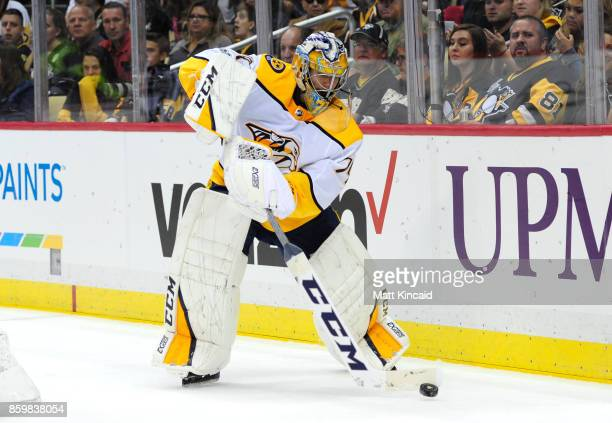 Juuse Saros of the Nashville Predators passes te puck against the Pittsburgh Penguins at PPG PAINTS Arena on October 7 2017 in Pittsburgh Pennsylvania