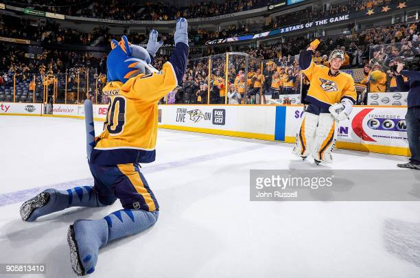 Juuse Saros of the Nashville Predators skates as First Star of the Game with team mascot Gnash following a 10 win against the Vegas Golden Knights...