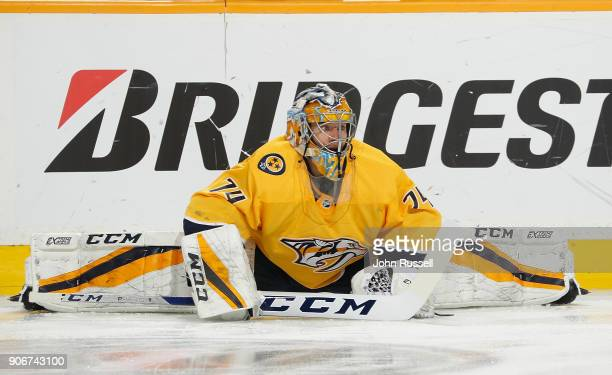 Juuse Saros of the Nashville Predators stretches in warmups prior to an NHL game against the Arizona Coyotes at Bridgestone Arena on January 18 2018...