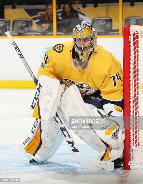 Juuse Saros of the Nashville Predators tends net against the New York Islanders during an NHL game at Bridgestone Arena on October 28 2017 in...