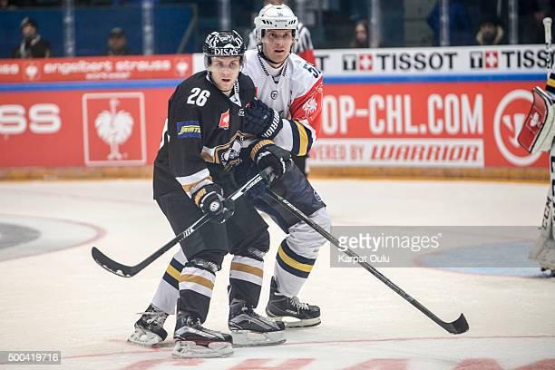 Juusi Ikonen of Karpat Oulu and Kalle Kaionmaa of Espoo Blues during the Champions Hockey League quarter final between Karpat Oulu and Espoo Blues at...