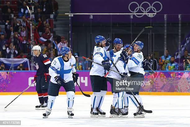 Juuso Hietanen of Finland celebrates his third period goal with Leo Komarov Sami Lepisto Olli Jokinen and Tuomo Ruutu in the second period against...