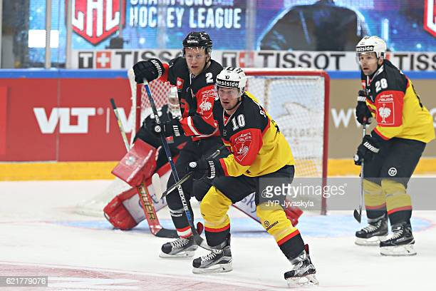 Juuso Pulli of Jyvaskyla battles in from of the net with Tristan Scherwey of Bern during the first person of Champions Hockey League Round of 16...