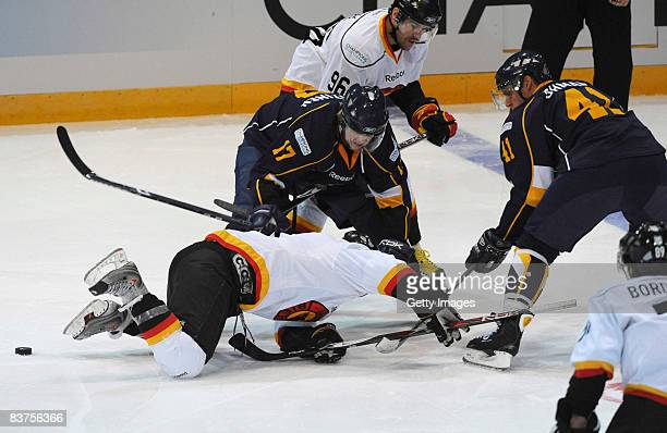 Juuso Puustinen and Stefan Ohman of Espoo Blues fight for the puck during the IIHF Champions Hockey League match between Espoo Blues and SC Bern on...
