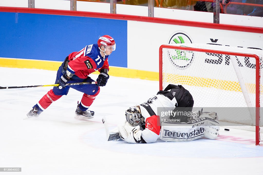#71 Juuso Puustinen of IFK Helsinki scores from the first shootout attempt during the Champions Hockey League Round of 32 match between IFK Helsinki and TPS Turku at Helsingin Jaahalli on October 11, 2016 in Helsinki, Finland.