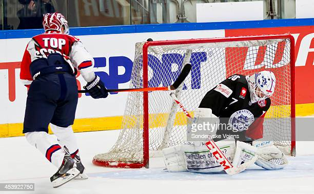 Juuso Puustinen of IFK Helsinki scores past Goalie Jeff Frazee fails to save the winning goal during the Champions Hockey League group stage game...