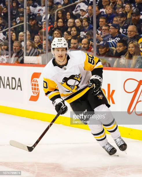 Juuso Riikola of the Pittsburgh Penguins follows the play around the boards during first period action against the Winnipeg Jets at the Bell MTS...