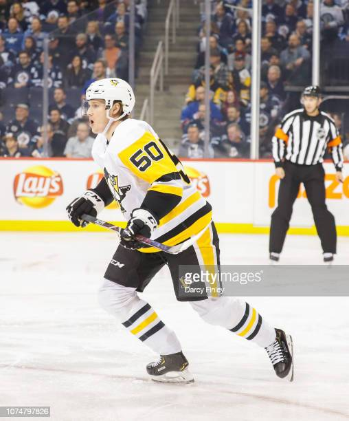 Juuso Riikola of the Pittsburgh Penguins keeps an eye on the play during first period action against the Winnipeg Jets at the Bell MTS Place on...