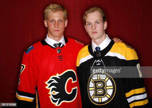 Juuso Valimaki 16th overall pick of the Calgary Flames and Urho Vaakanainen 18th overall pick of the Boston Bruins pose for a portrait during Round...