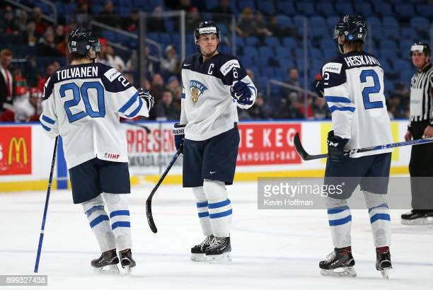 Juuso Valimaki of Finland celebrates after scoring on Denmark with Eeli Tolvanen and Miro Heiskanen in the second period during the IIHF World Junior...