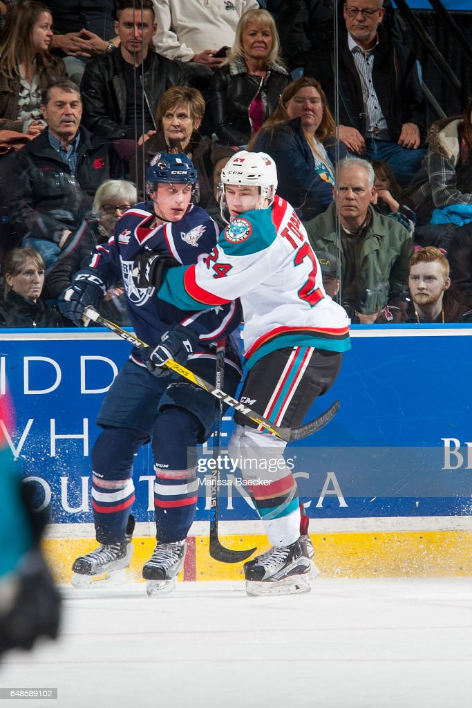 Juuso Välimäki #6 of the Tri-City Americans is checked by Kyle Topping #24 of the Kelowna Rockets on March 4, 2017 at Prospera Place in Kelowna, British Columbia, Canada.