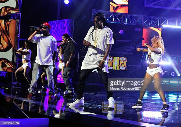 Juvenile and 2 Chainz perform onstage at the BET Hip Hop Awards 2013 at Boisfeuillet Jones Atlanta Civic Center on September 28 2013 in Atlanta...