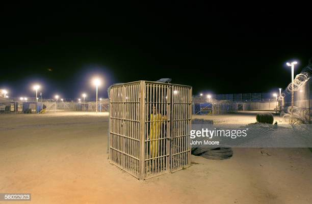 A juvenile detainee stands in a solitary confinement cage in the Abu Ghraib Prison October 27 2005 which is located on the outskirts of Baghdad Iraq...