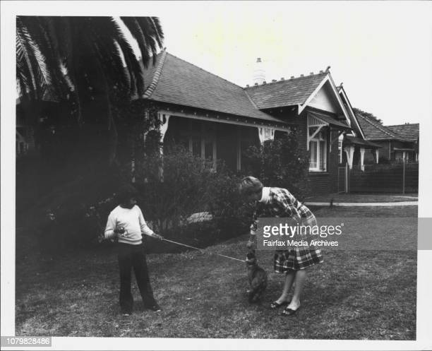Juvenile Remand centres The cottage at CroydonPic shows LR Arnie and Jenny play with Sarah the dog outside the cottage September 13 1985