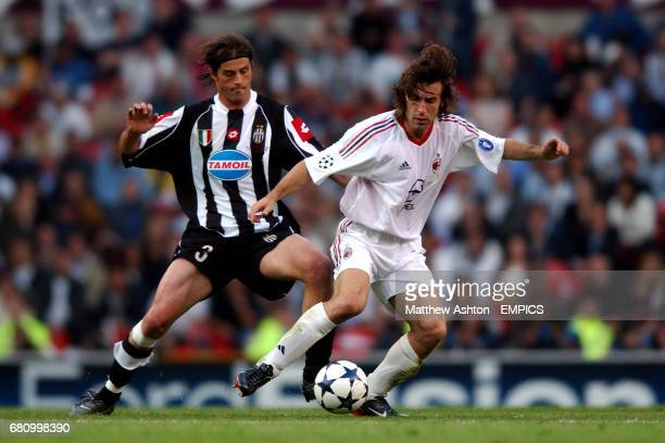 Juventus' Alessio Tacchinardi and AC Milan's Andrea Pirlo battle for the ball