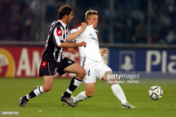 Juventus' Alessio Tacchinardi and Real Madrid's Guti battle for the ball